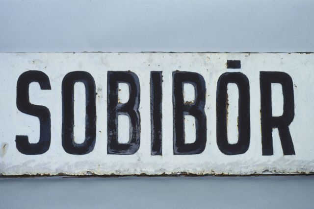 Picture of the sign for the train station at Sobibor.