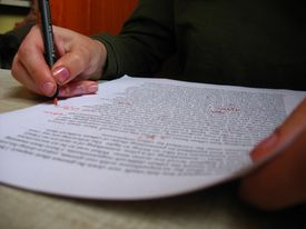 Editing an Essay with red pen