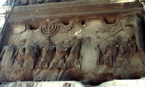 Detail of the Arch of Titus, depicting Romans taking spoils from Jerusalem by Tom Elliott (1988)