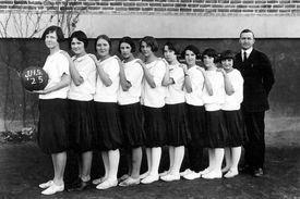 Black and white photo of a girls' high school basketball team.