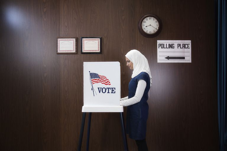 Middle Eastern woman voting.