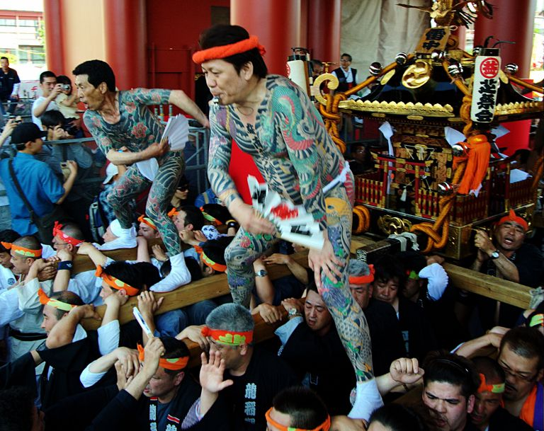Yakuza members at a festival - note the missing pinkie finger