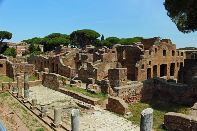 Large insula apartment building in Ostia Antica on sunny day.
