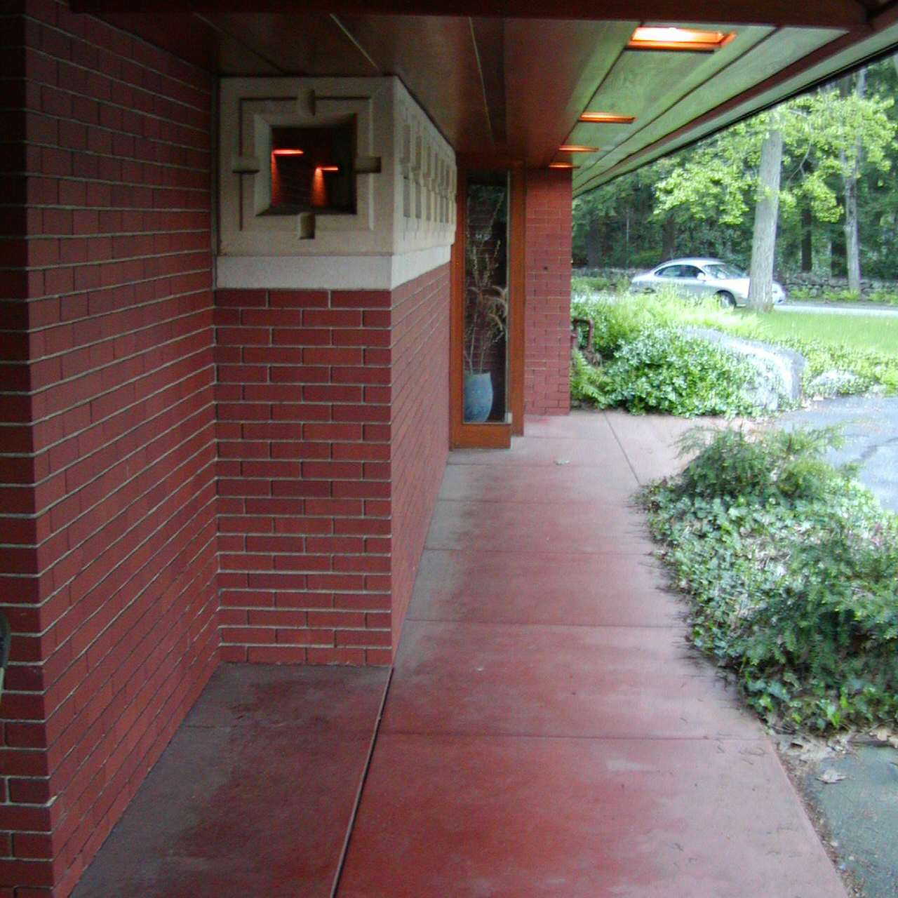 Zimmerman House entry, Frank Lloyd Wright red tile floor against red brick and light clerestories