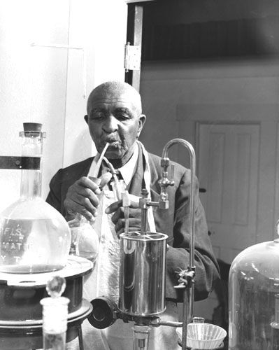 This is a photo of George Washington Carver at work in his lab.