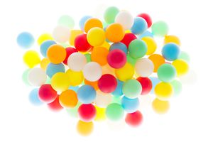 The color and volume of the balls are physical properties. Their flammability and reactivity are chemical properties.