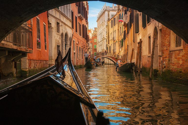 gondola floating under bridge in Venice