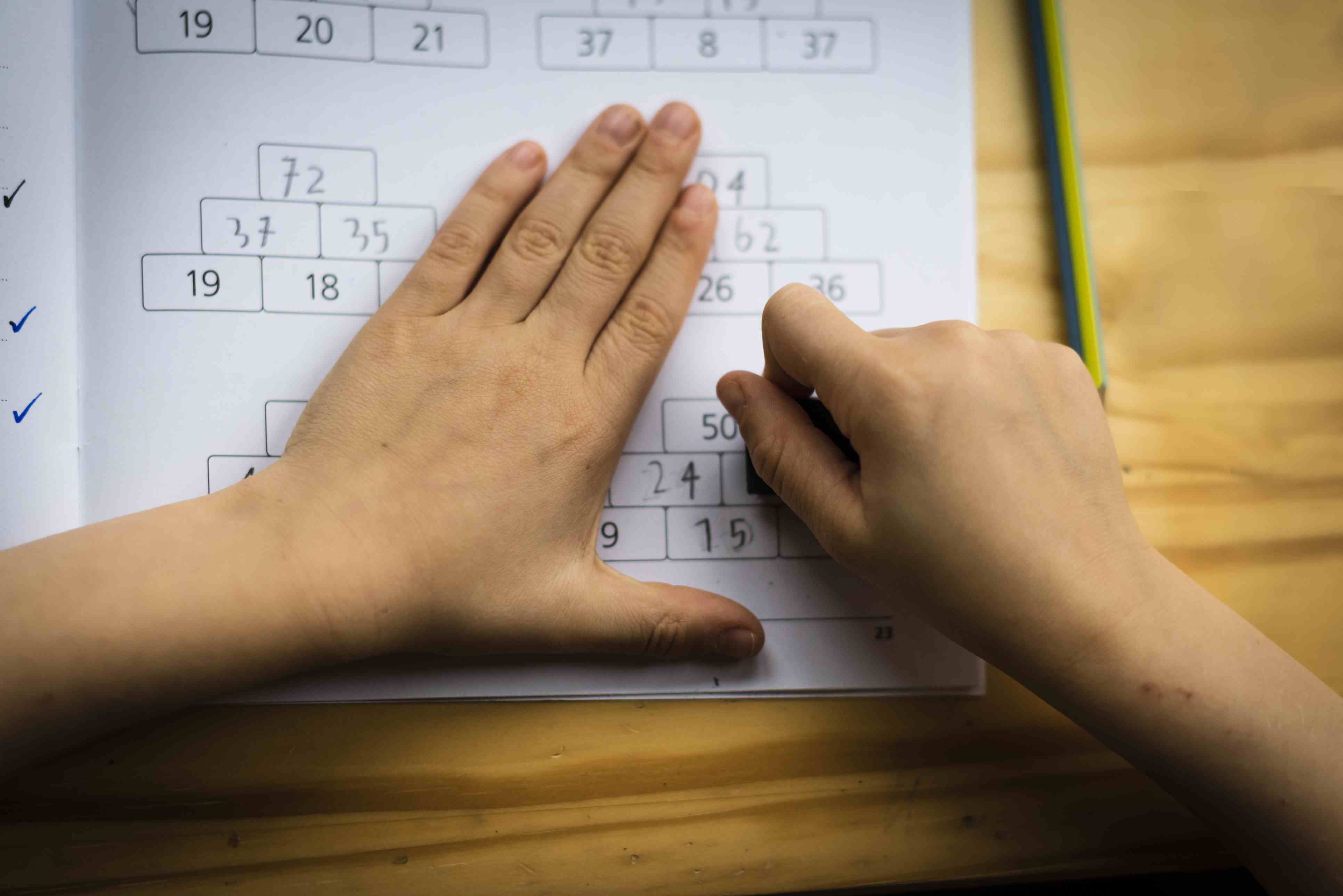 Schoolboy at his desk doing his math homework