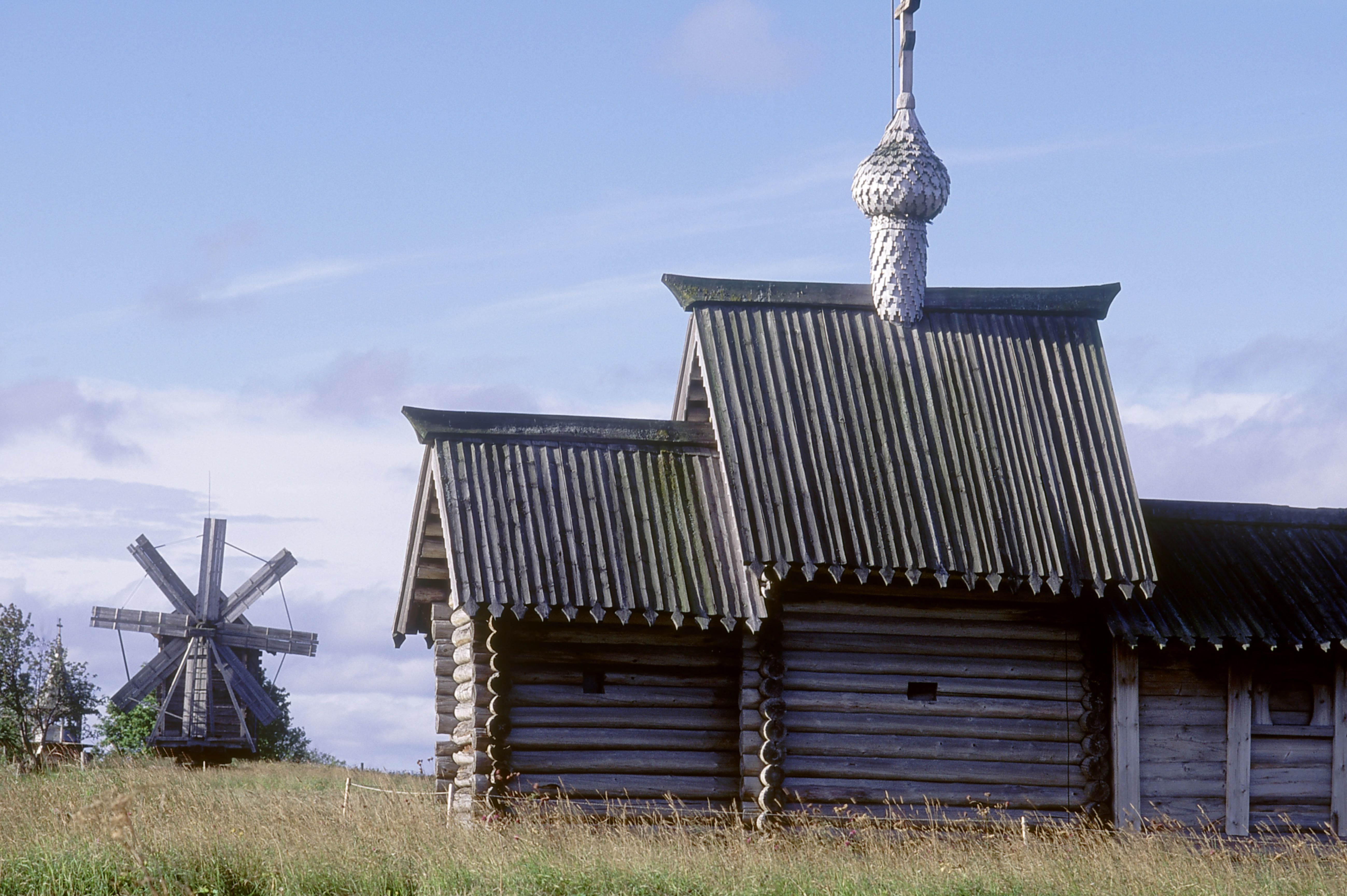 Simple wooden church may be oldest in Russia, with windmill on Kizhi Island