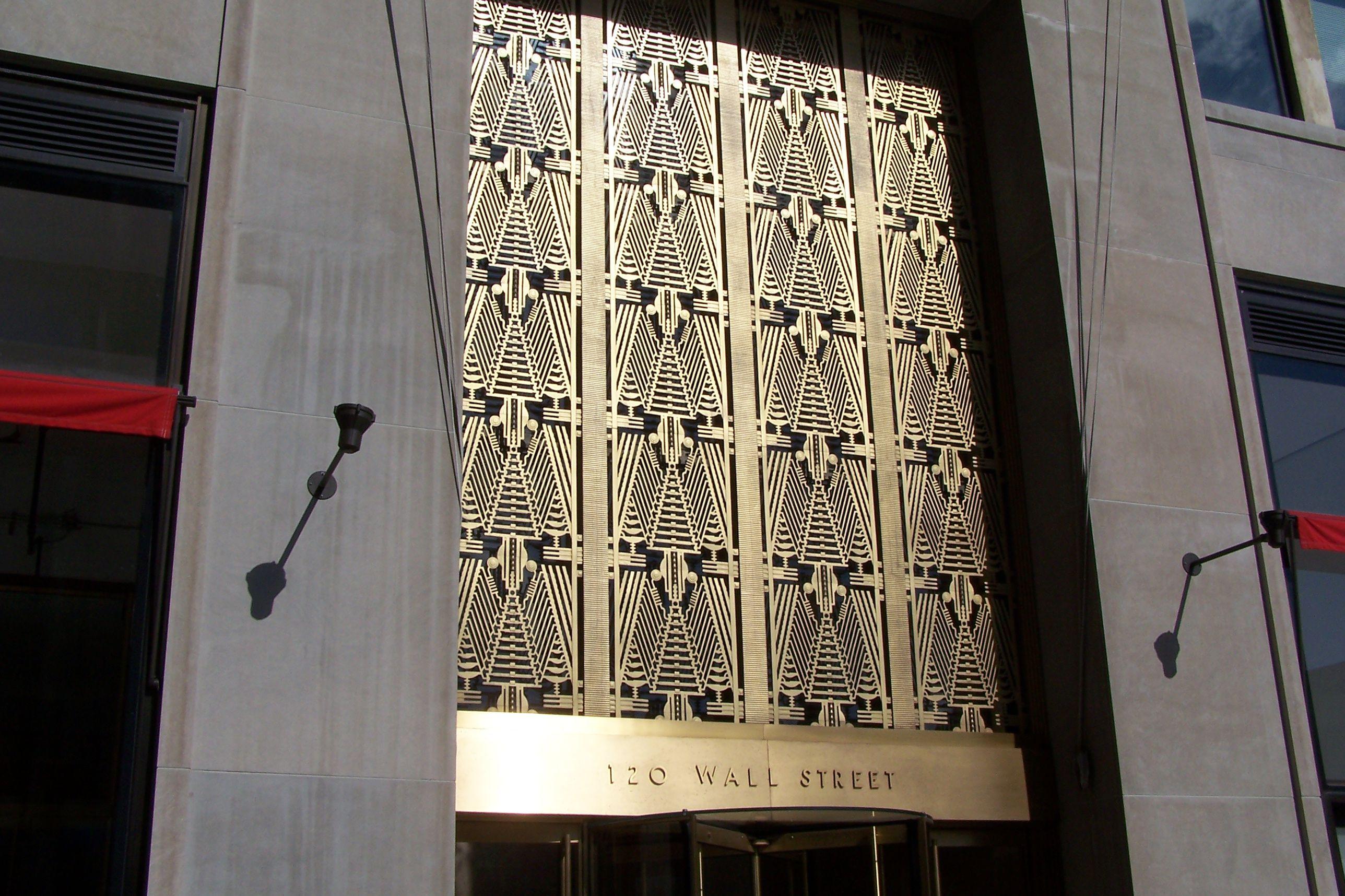 The shiny metal art deco entrance to 120 Wall Street