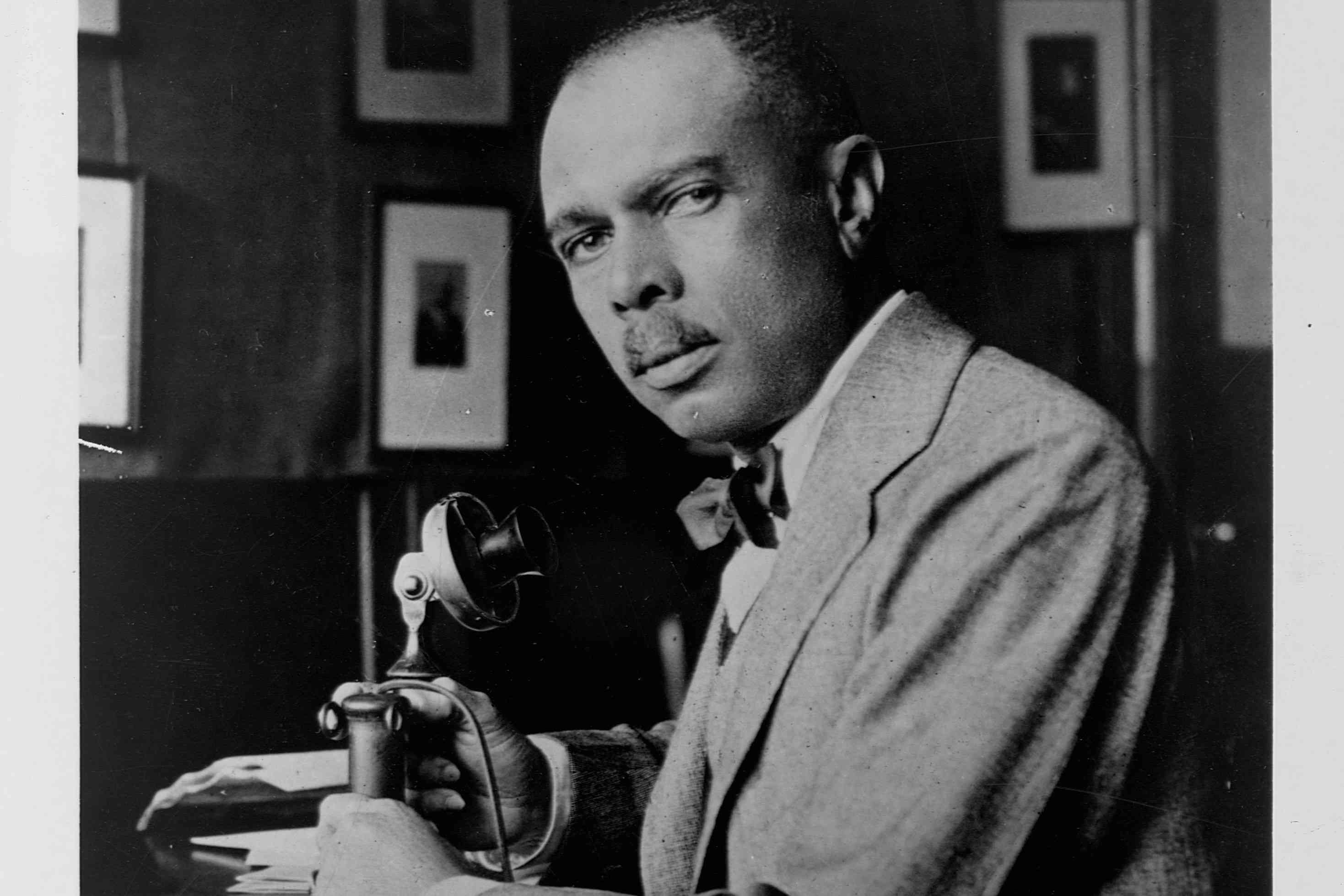 James Weldon Johnson holding a telephone from the early 1900s