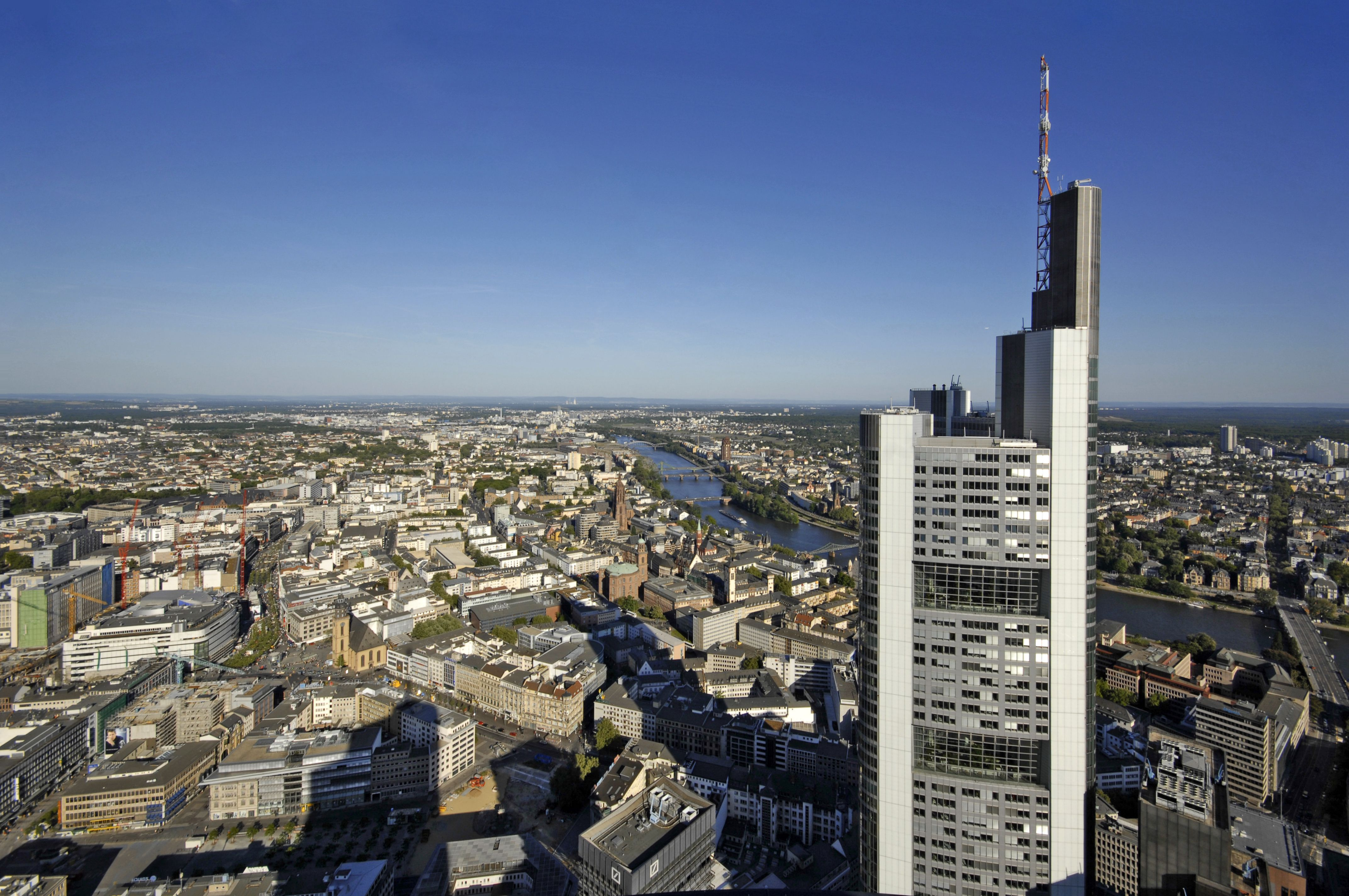 top of modern skyscraper, asymmetric, overlooking a river in Germany