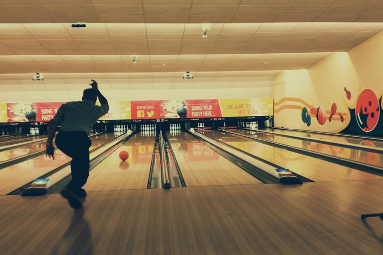 Rear view of man in bowling alley