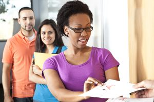 Education: Multi-ethnic group of college students in classroom.
