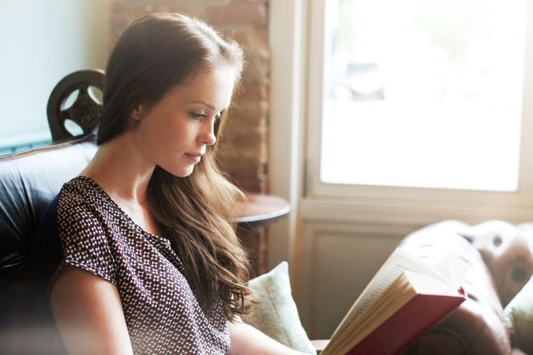 Young woman reading book.