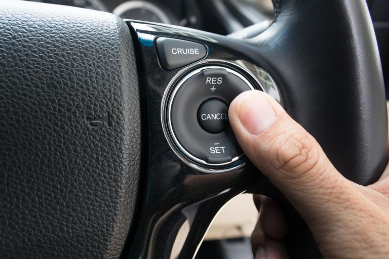 hand pushes Cruise control buttons