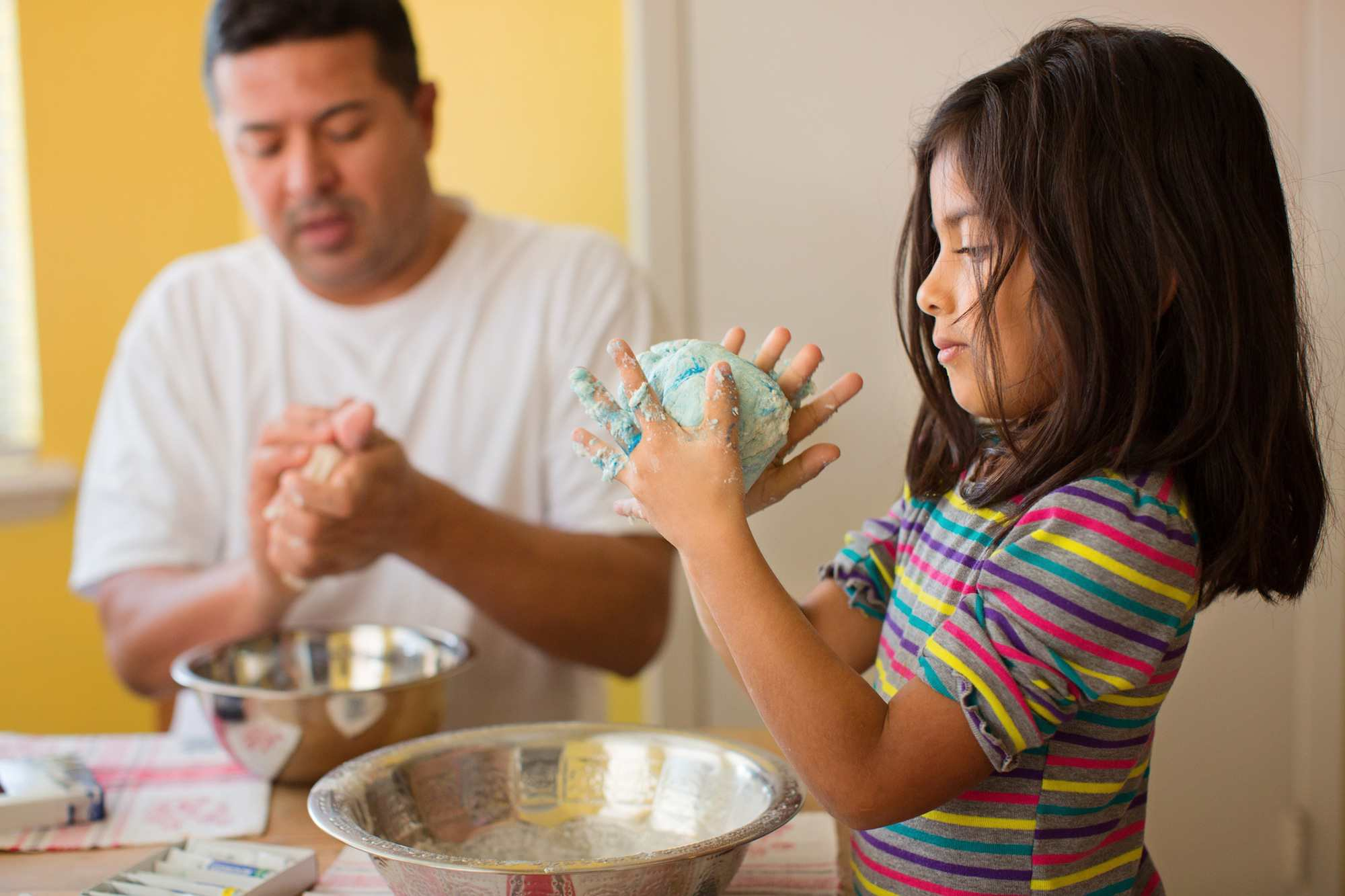 Father and daughter making homemade playdough