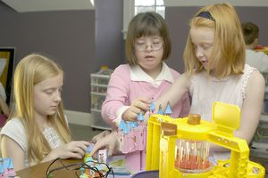 girl with down syndrome playing with classmates