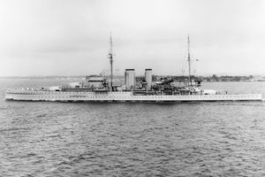 Black and white photograph of the HMS Exeter on the water.