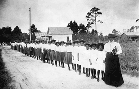 Mary McLeod Bethune with students of the Daytona Educational and Industrial Training School for Negro Girls