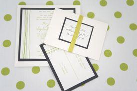 Wedding invitations on polka dot background