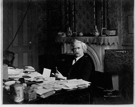 Mark Twain at his writing desk