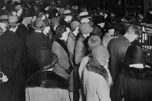 People standing in long lines at a financial institution