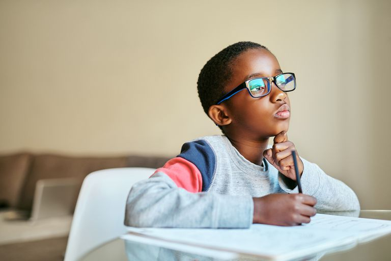 Shot of an adorable little boy doing his schoolwork at home