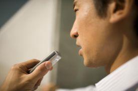 Businessman using digital voice recorder