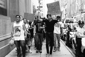 Protestors associated with Occupy Wall Street call for political and economic reforms, evoking the components of political process theory.