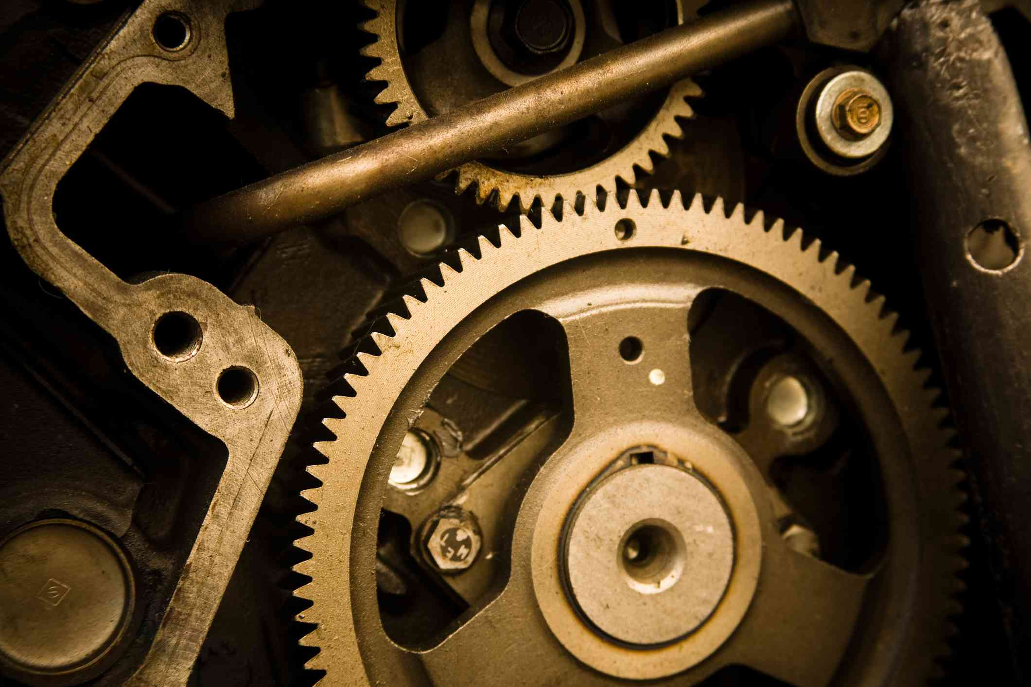 The interlocking parts and gears of a mechanism symbolize Durkheim's book The Division of Labor in Society