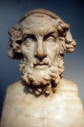 Marble bust of Homer agaisnt blue background.