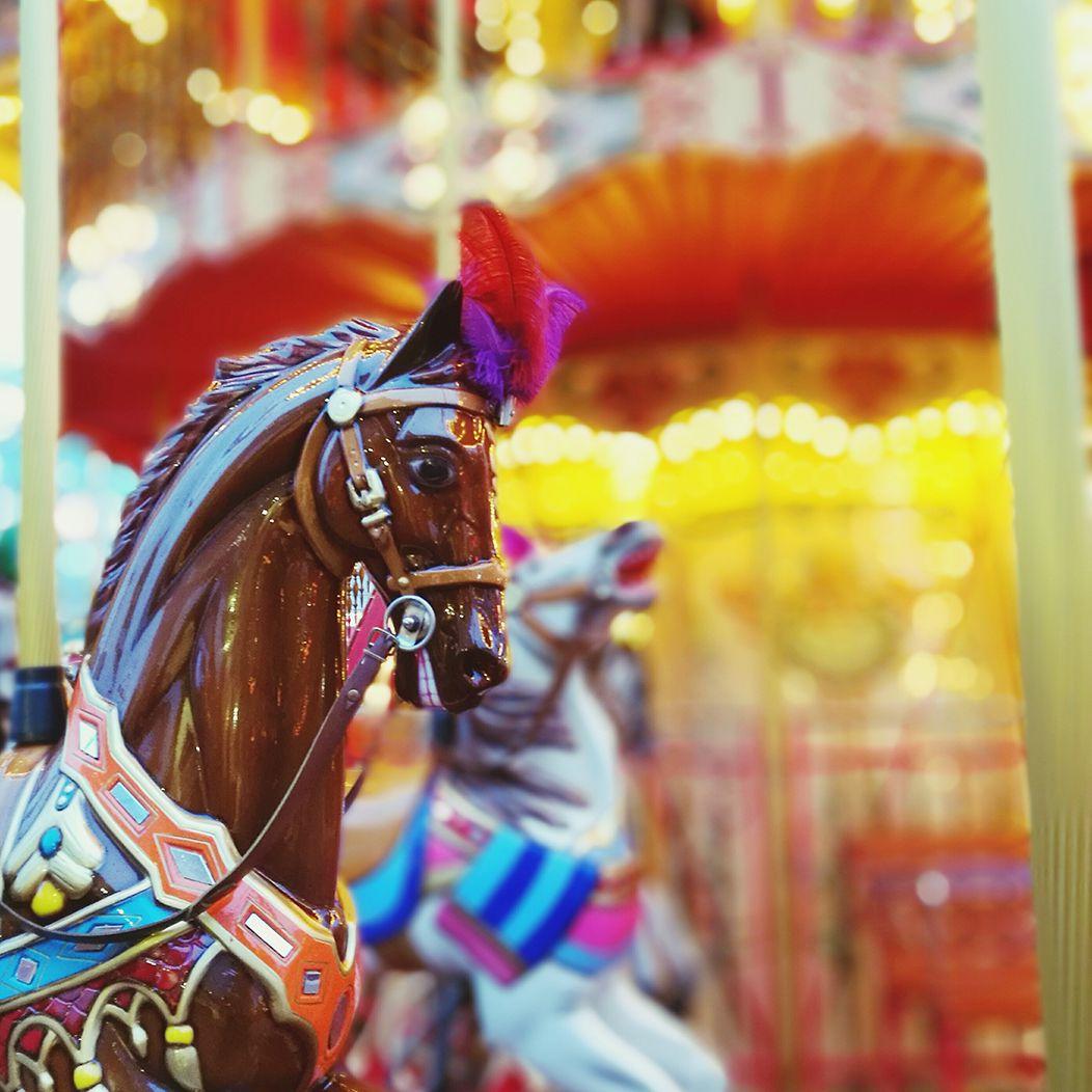 Horses on a carousel.