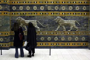 Women standing in front of the Ishtar Gate in the Pergamon Museum.