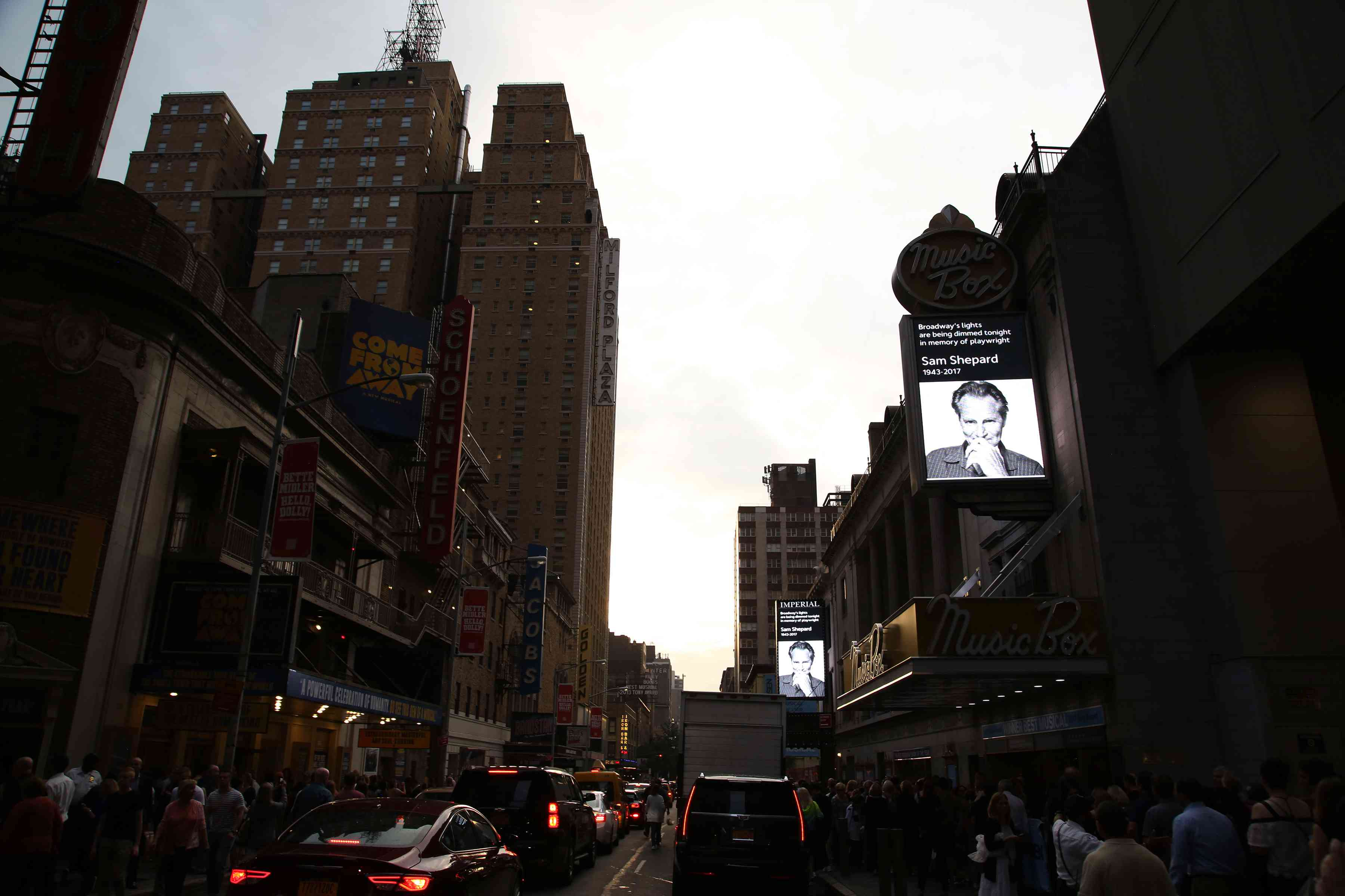 The marquees on Broadway dimmed at sunset with an image of Shepard on all the signs