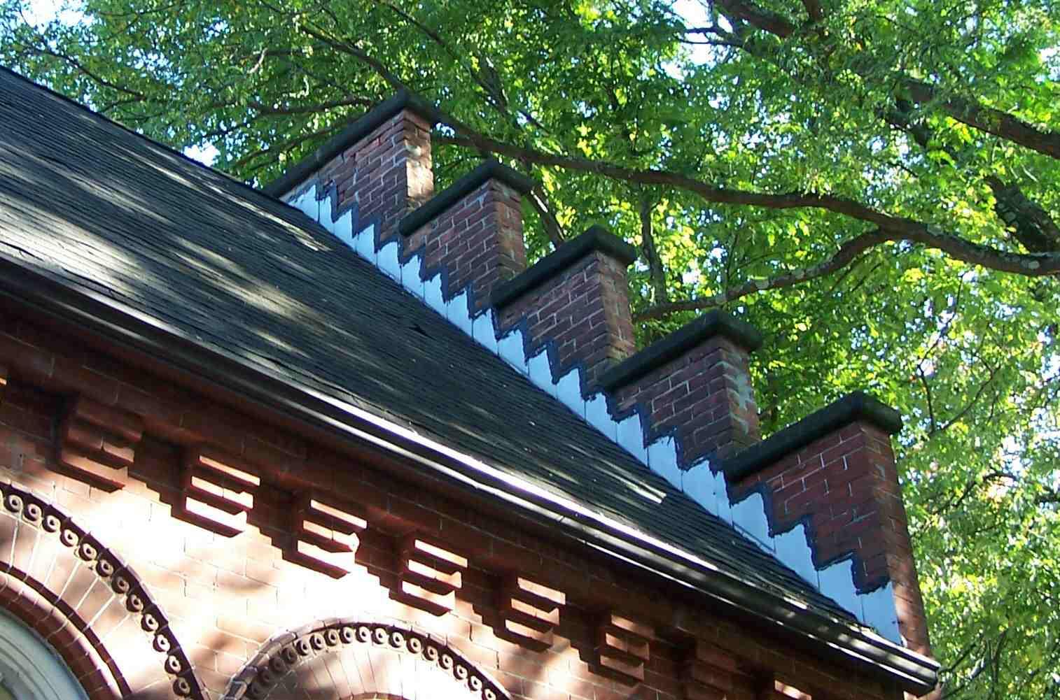 metal flashing along the parapet of a Stockbridge, Massachusetts brick building