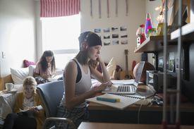 Headphones high school student on computer