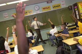 Classroom of students raising hands