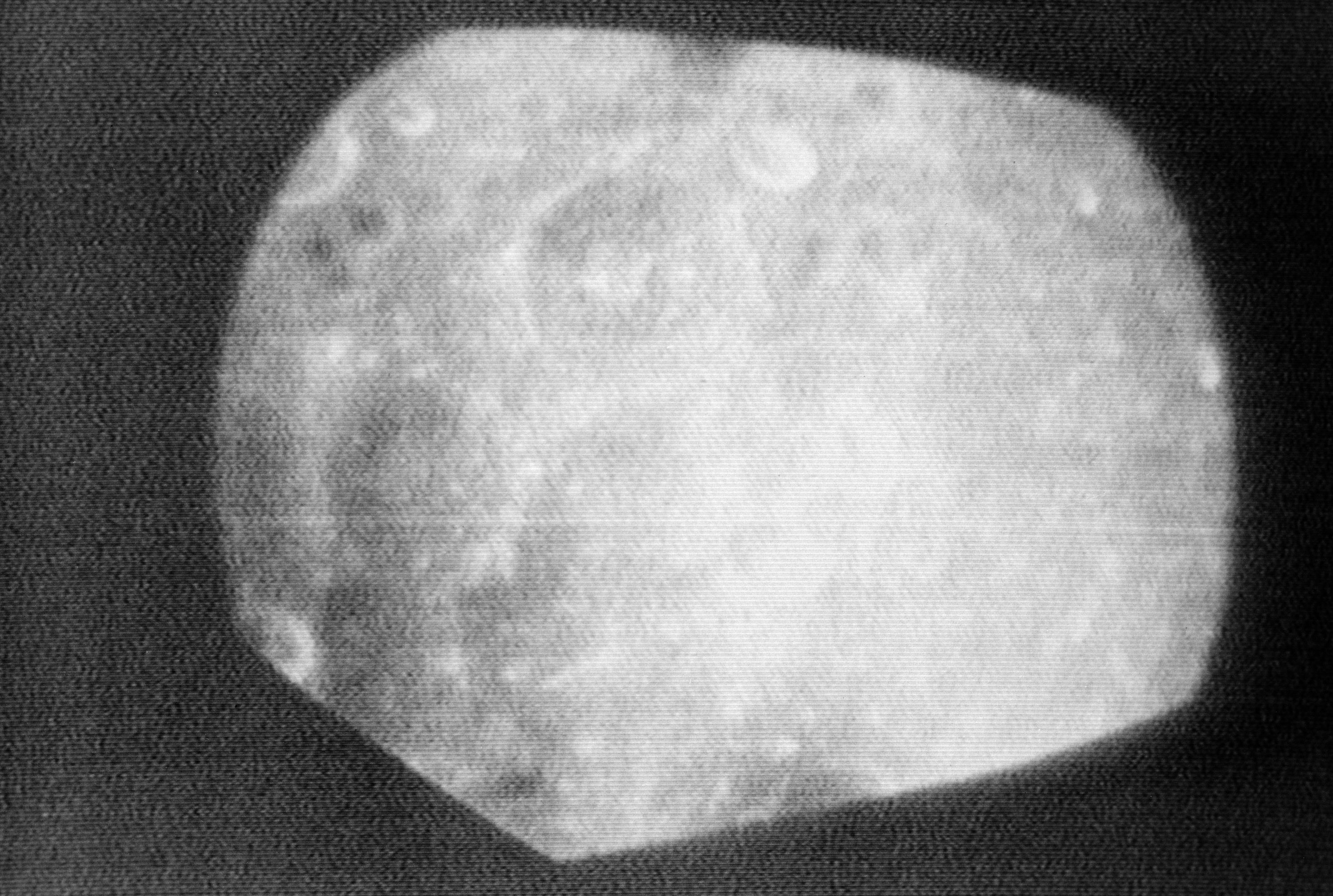 Grainy image of the lunar surface as seen from Apollo 8