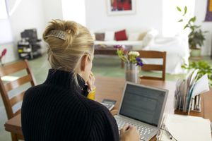 Woman checking email on laptop.
