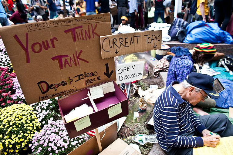 A sign points to a think tank discussion area created by Occupy Wall Street movement in Zuccotti Park in Lower Manhattan on Tuesday, October 11, 2011.