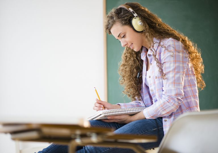 Student studying with headphones