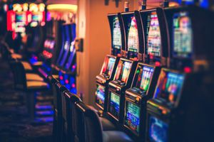 Illuminated Slot Machines In Darkroom