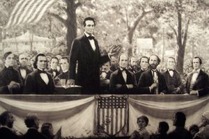Black and white artist rendering of a debate between Abraham Lincoln and Stephen Douglas.