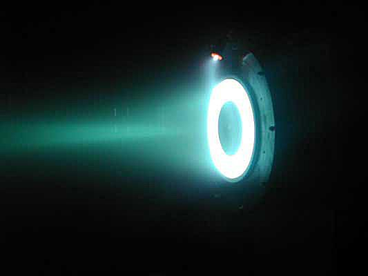 This is a photo of a Hall Effect thruster (ion drive) in operation.