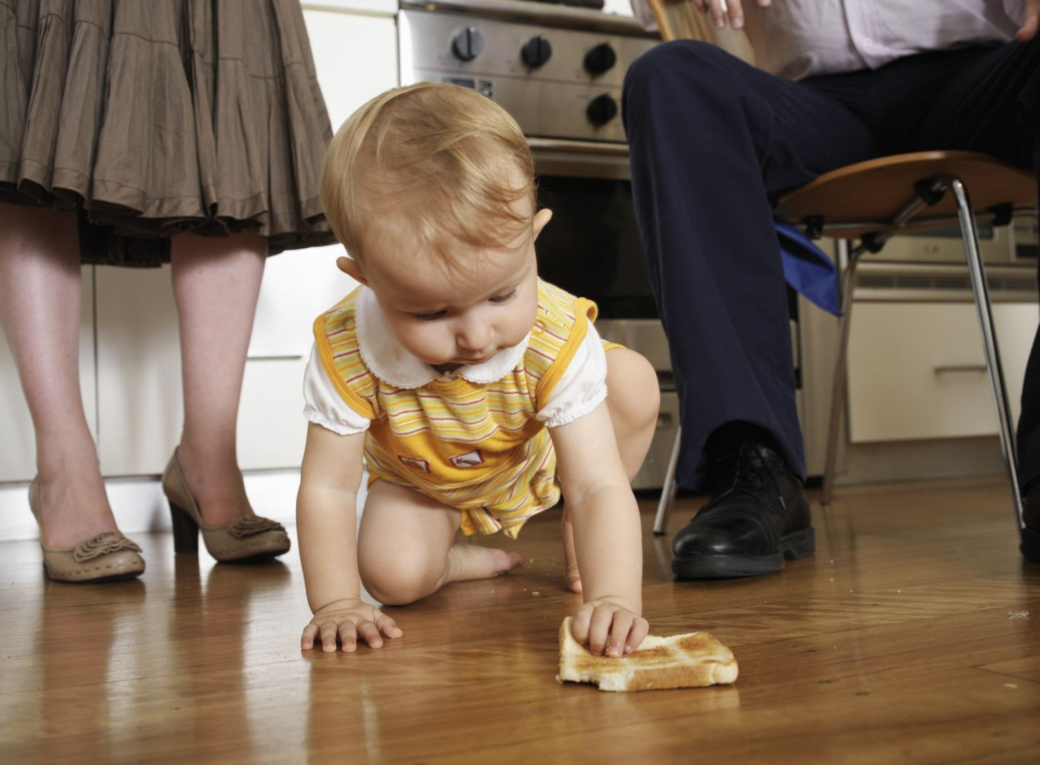 Baby With Food on Floor