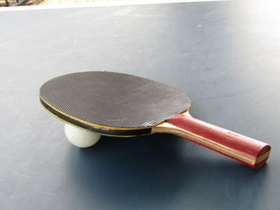 Close Up Of Table Tennis Racket And Ball