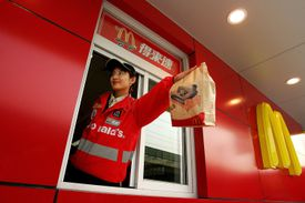 Asian McDonald's worker leans out of Chinese drive-thru