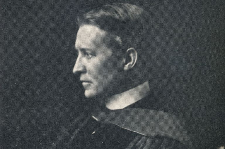 Black and white portrait of Bertram Grosvenor Goodhue, American Architect, in academic regalia