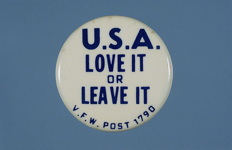 "A button bearing the slogan, ""U.S.A. Love it or leave it."""